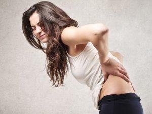Боль в области поясницы у женщин